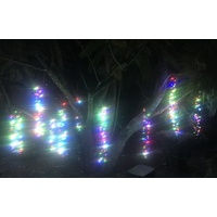 10M Multi Coloured LED Firecracker Curtain Light on a green wire